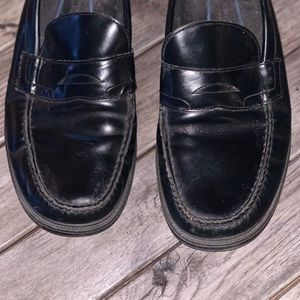 Rockport penny loafers with some minor scratches.